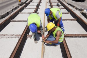 40562083 - railway workers on a construction site in a street