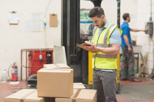 36413120 warehouse worker with clipboard in warehouse