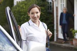 46779388 - female care worker visiting senior woman at home